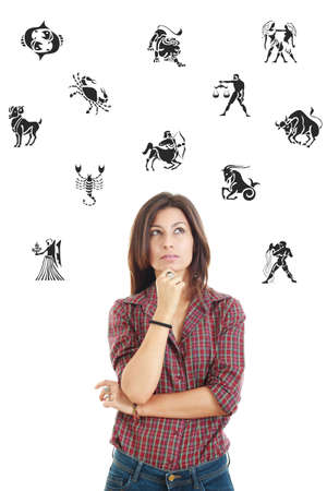 questionable: Ordinary casual beautiful woman surrounded with zodiac signs thoughtfully looking up with questionable face expression, photo conception problems with horoscope, good and bad sides and features Stock Photo