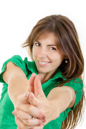 Happy smiling young woman making with hands fingers sign like shooting. Girl making gun gesture like handgun isolated on white. Sure in herself female person goes on hunt for love photo