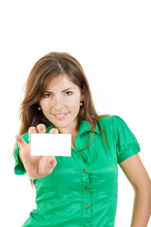 pretty smiling young woman or girl in green shirt with bussiness card against white background. Copy space for text and marketing ideas and slogans photo