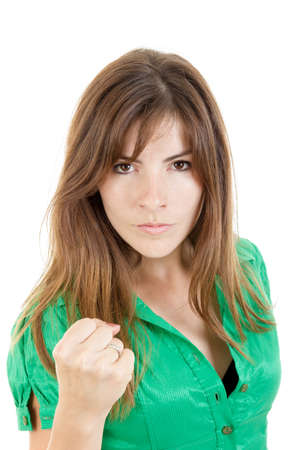 european expression face: Pretty young angry brunette woman throwing punch with fist to camera with serious face expression