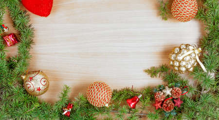ornamentals: Christmas decoration with fir tree  and ornamentals gifts or presents on white wood board with copyspace , blank place for text and advertising, greeting card for New Years holidays