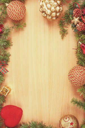 ornamentals: Christmas decoration with fir tree  and ornamentals on wood board with copyspace , blank place for text and advertising, greeting card for New Years holidays , vintage retro concept Stock Photo