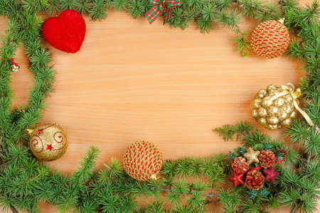 ornamentals: Christmas decoration with fir tree  and ornamentals on wood board with copyspace