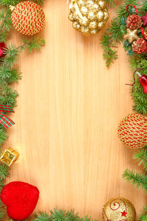 ornamentals: Christmas decoration with fir tree  and ornamentals on wood board with copyspace , blank place for text and advertising, greeting card for New Years holidays Stock Photo