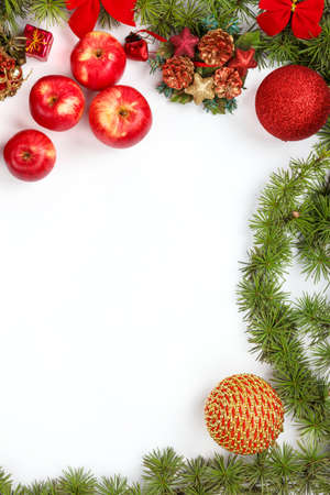 ornamentals: Wonderful Christmas decoration with red apples ornamentals and green fir tree on white surface with copyspace. Christian festive decoration. Blank space place for text and advertising, family or business greeting card for New Years holidays