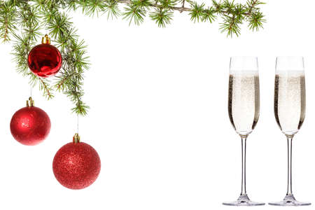 new yea: Wonderful Christmas decoration with red ornamentals and green fir tree on white surface with two glasses of champagne, advert copyspace. Christian festive decoration. Blank space place for text and advertising, family or business greeting card for New Yea