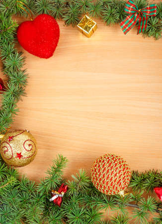 ornamentals: Wonderful Christmas decoration with fir tree and ornamentals gifts or presents on wood board  or table with copyspace , blank space place for text and advertising, greeting card for New Years holidays