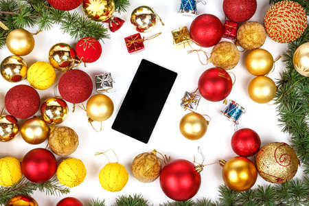 finery: Mobile phone with Christmas gifts and finery , New year shopping with decoration