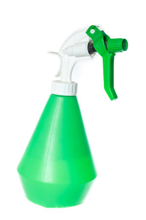 Cleaning equipment, green garden plastic foggy sprayer bottle. Object isolated on white background without shadows photo
