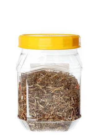 Dried natural rooibos herbal tea in plastic jar. Object isolated on white background without shadows photo
