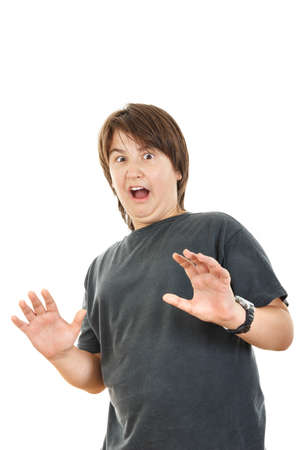 widespread: Shocked and scared young caucasian chubby kid or boy gesturing surprise  holding his hands widespread because fear, isolated on white background Stock Photo
