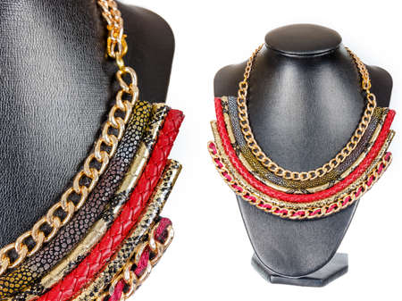 showpiece: Beautiful stylish handmade handcrafted woman bijouterie or female vintage fashion antique red colorful jewelry necklace on black model showpiece doll isolated on white background. Close up shoot