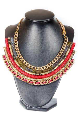 showpiece: Beautiful stylish handmade crafted red woman bijouterie or female vintage fashion antique glamor colorful jewelry necklace on mannequin model showpiece doll isolated on white background. Studio shoot