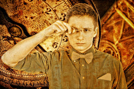 oracle: Modern prophet holds key to his eye, as a symbol of prophecies of future. The prophecy of future events Oracle with time retro background. Young serious man in shirt and bow tie holds door locker.