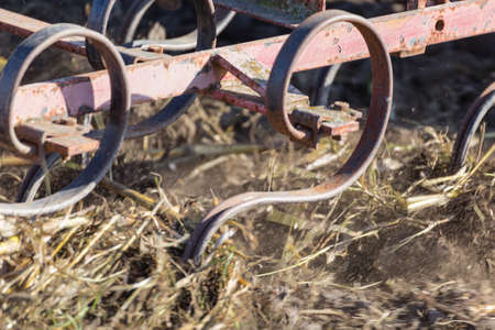plough: Close Up Detail of an Agricultural Plough in Action Plowing an Overwintered Field in Preparation for Planting the Spring Crop. Plow on the Field Ready to Work Stock Photo