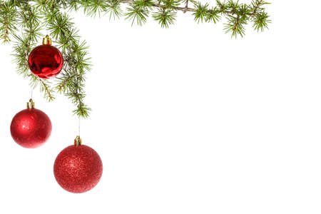ornamentals: Wonderful Christmas decoration with red ornamentals and green fir tree on white surface , advert copyspace. Christian festive decoration. Blank space place for text and advertising, family or business greeting card for New Years holidays Stock Photo
