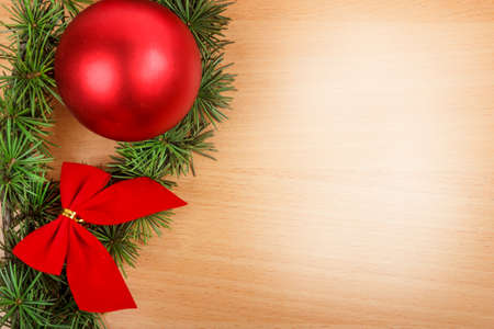 ornamentals: Wonderful Christmas decoration with fir tree and red ornamentals on wooden board or table with copyspace , blank space place for text and advertising, greeting card for New Years holidays Stock Photo
