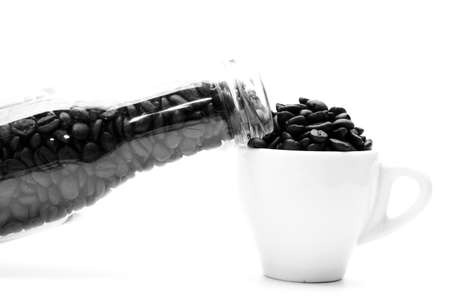 close up of bottle and coffee seed Stock Photo