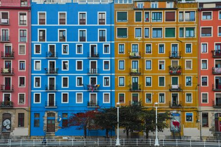 colored buildings with symmetry on a river