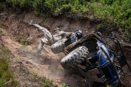 A man falls off an ATV. Extreme situation