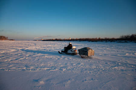 Traveling and outdoor activities in winter on snowmobiles.