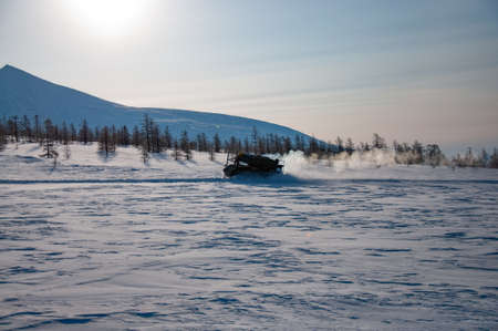 Tracked all-terrain vehicle in winter ladscape in Kamchatka
