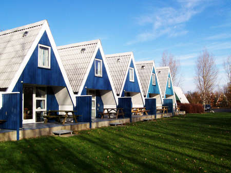 symetry: Blue holiday cottages Stock Photo