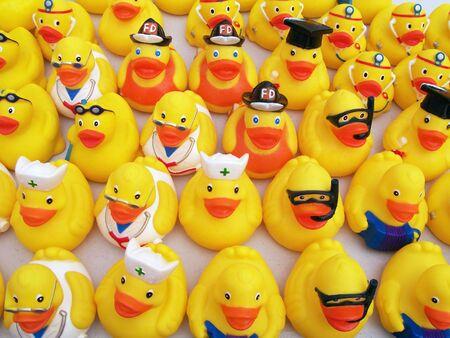yellow bathducks in uniforms Stock Photo