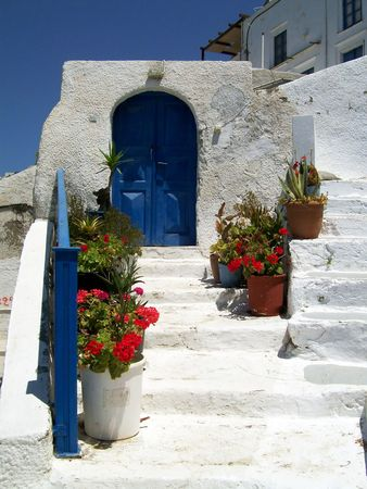a lovely blue door  in Santorini with the surrounding all painted white Stock Photo