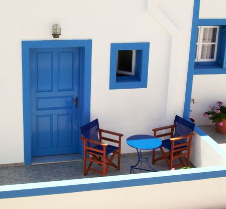This traditionally painted house is commonly found on greece photo