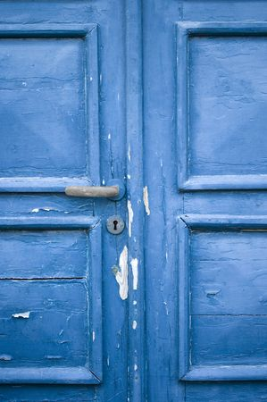 blue door with cracked and peeling paint photo