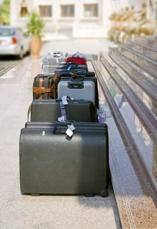 suitcases outside hotel steps