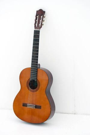 acoustic guitar leaning on a white wall Banco de Imagens - 5357532