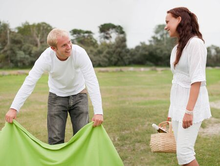 Couple preparing romantic picnic Stock Photo - 5418970