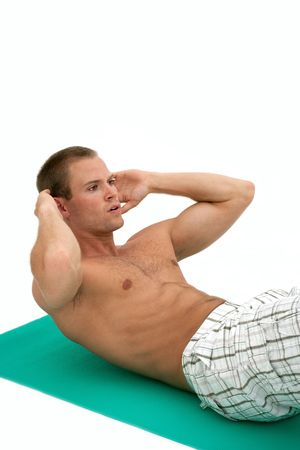 Young muscular man doing situp exercises on mat Stock Photo - 5418962