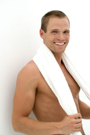 happy smiling man with towel after workout