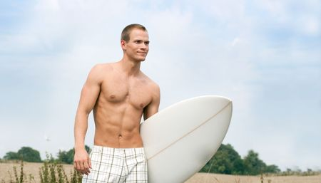 Handsome Surfer on the way to the beach photo