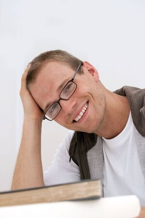 Young male student smiling wearing glasses
