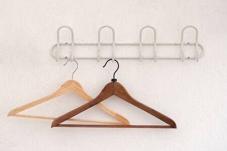 coathangers: couple of wooden coathangers on a wall