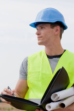 Young male architect looking confident