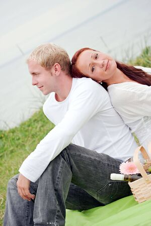 young couple on romantic picnic photo