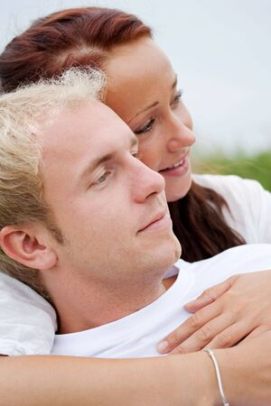 young couple holding and hugging romanticly photo