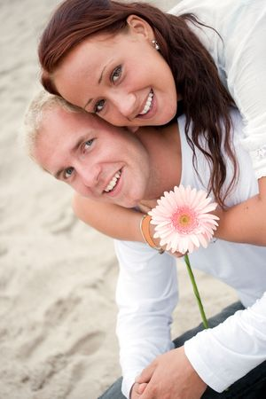 summer fun on the beach for this loving couple photo
