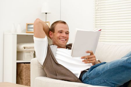 young man relaxing with book Stock Photo