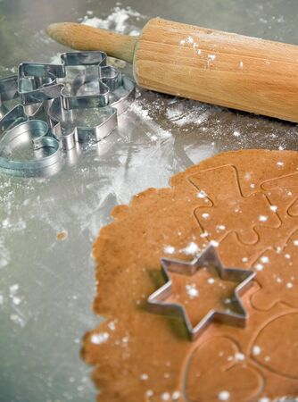 baking still life with cookie cutters, dough and rolling pin photo