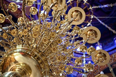 Huge beautiful brass chandeler hanging in Greek chruch.