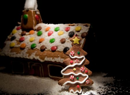 spotlit: Spotlit gingerbread house with candy and snow Stock Photo
