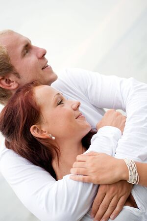 loving couple hold each other. beach setting Stock Photo - 6117397