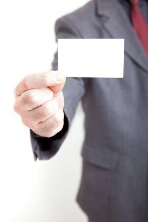 ビジネスの男性と空白のカード 写真素材