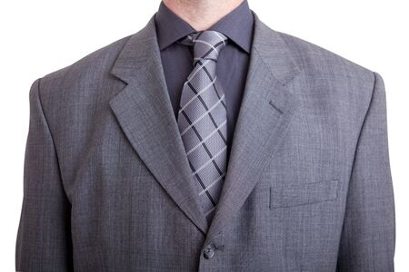 man wearing gray suit and tie